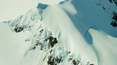Aerial view of snow covered mountain peaks Alaska USA Stock Footage