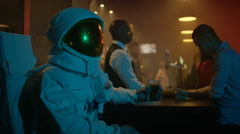 4K Astronaut relaxing in nightclub, drinking beer & blending in with the crowd - stock footage