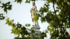 Pan shot of the statue of Ludovico Ariosto in Ferrara Stock Footage