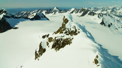 Aerial view of barren landscape and snow capped mountains Alaska Stock Footage