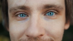 Highly Detailed Close-Up Portrait of Handsome Man With Beautiful Blue Eyes Stock Footage