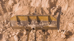 Dump truck being loaded with soil by shovel. Stock Footage