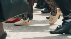 Feet of walking people at city Stock Footage