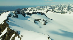 Aerial view of rugged snow covered mountains Alaska USA Arkistovideo