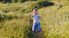 Baby makes first steps hesitantly. Stock Footage