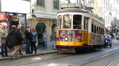 Historic old tram waits in streets of Lisbon Stock Footage