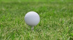 Apply is a blow to the golf ball on the grass. - stock footage
