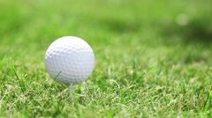 Blow to the golf ball on the grass. Stock Footage