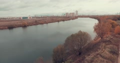 Aerial Shot of Public Park and River Bank in Autumn Colors Stock Footage
