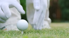 Golfer putting a golf ball and strikes. - stock footage