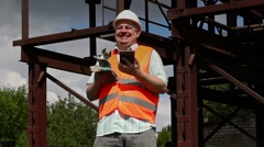 Worker watching tablet PC and laughs Stock Footage