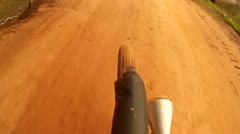 Action cam POV  of hybrid mtb road bicycle riding on a muddy road in Asia Stock Footage