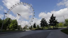 Timelapse of London Eye, Millennium Wheel, with tourists Central London Stock Footage