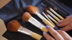 Makeup Brushes and female hands with manicure Stock Footage
