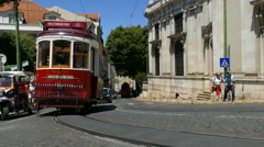 Historic red old tram in streets of Lisbon Stock Footage