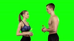 Couple with water bottles. Green screen Stock Footage