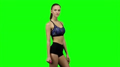 Woman is engaged with weights in one hand. Green screen Stock Footage