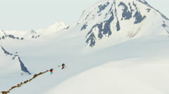 Aerial view of mountaineers on a snow covered mountain in Alaska America - stock footage