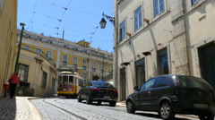 Historic yellow old tram in streets of Lisbon Stock Footage