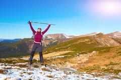 Happy Hiker with triumph arms raised in mountains landscape Stock Photos