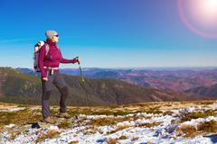Female Hiker Staying on Mountain Trail and Enjoying Nature Stock Photos