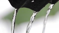 Closeup water runs out of rain gutter Stock Footage