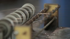 Textile industry yarn spools on spinning machine in a factory. Close up Stock Footage