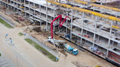 Construction area. Pouring concrete. Tilt-shift. 4K time lapse - stock footage