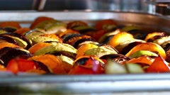 Fresh vegetables roasting in a clear dish in the oven - stock footage