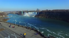 Drone taking off in Niagara Falls and flying towards wide river Stock Footage