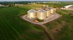 Aerial view of modern stainless steel agricultural grain silos Stock Footage