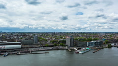 A'DAM Toren Amsterdam 4K, aerial time lapse of a busy city port in Amsterdam - stock footage