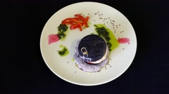 Chicken Burger with black bread painted by cuttlefish ink. 360 rotation Stock Footage
