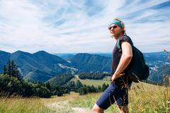 Young man traveler in mountain - stock photo
