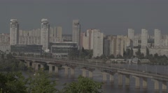 The bridge across the Dnieper river. Kiev. City skyline with tall buildings. Stock Footage