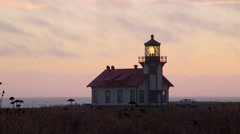 Lighthouse at Point Cabrillo, dusk with car - stock footage