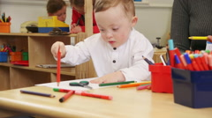 Down Syndrome Boy at Nursery Stock Footage