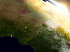 Niger and Nigeria from space during sunrise - stock illustration