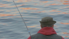 Evening fishing on the bait, the angler sits and waits - stock footage