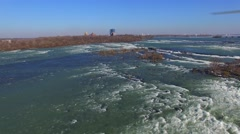 Wide shot of Niagara Falls with drone flying above river Stock Footage