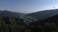 Panoramic view Mzymta River valley at sunset, greenwood and rocky ravine Stock Footage