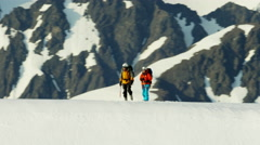 Aerial view male and female climbing team on Alaska mountain range Stock Footage
