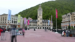 Time Lapse tourists take pictures at main square of Roza Khutor alpine resort Stock Footage