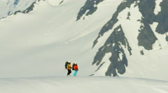 Aerial view male female climbers on snow covered mountains in Alaska - stock footage