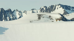 Aerial view of male and female mountain climbers in Alaska America Stock Footage