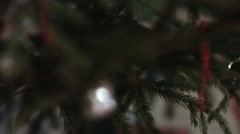 Close up of Christmas tree with ornaments of baubles, snowflakes, teddy bears Stock Footage