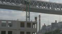 The crane moves construction bar in the evenings. construction Stock Footage
