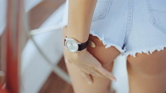 Sexy woman hand grasps the body in jean shorts. The model is back. Great ass. - stock footage