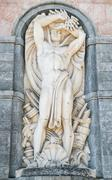 Statue of the god Neptune on the facade a hydroelectric plant. Stock Photos