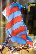 Red and blue foulard exposed in a boutique. Stock Photos